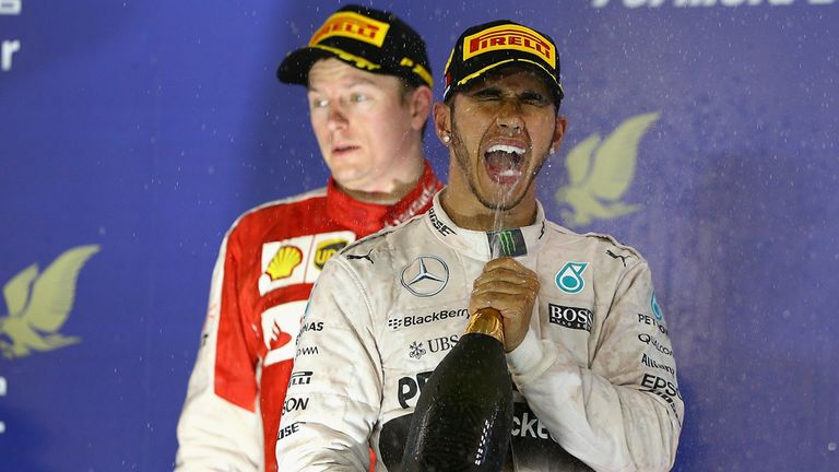 Lewis Hamilton celebrates on the Bahrain podium
