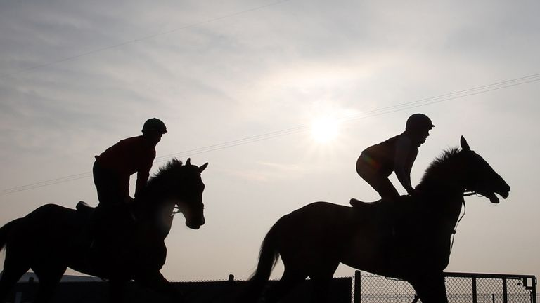 Horses and riders on the gallops early morning, ahead of the Grand Opening Day of the Crabbies Grand National Festival