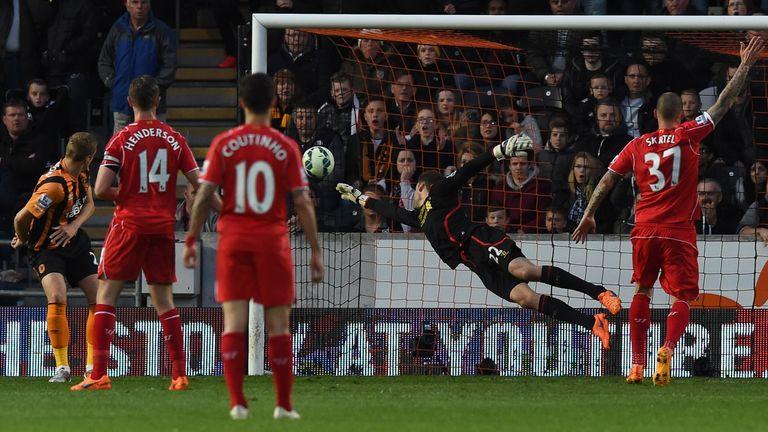 Hull City's English defender Michael Dawson (L) heads the ball past Liverpool's Belgian goalkeeper Simon Mignolet
