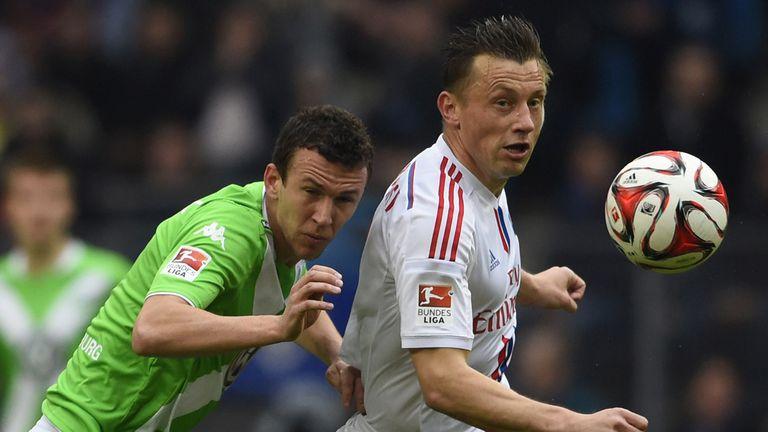 Hamburg forward Ivica Olic holds off Ivan Perisic