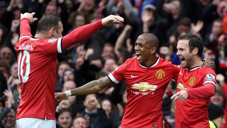 Juan Mata celebrates with Ashley Young and Wayne Rooney
