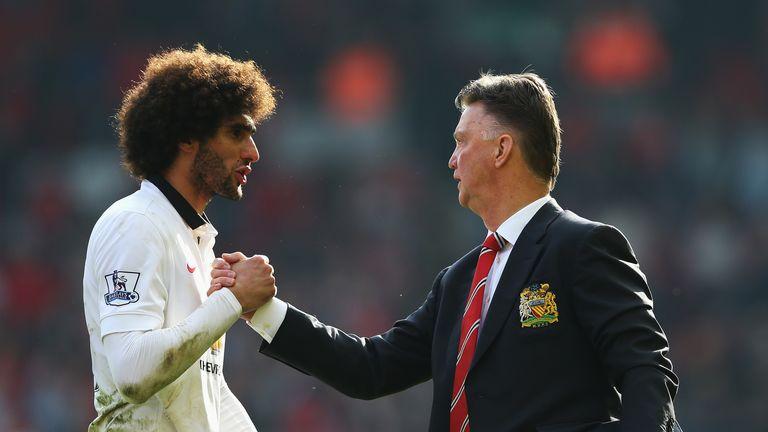 Louis van Gaal celebrates with Marouane Fellaini after Manchester United's win over Liverpool at Anfield, March 2015