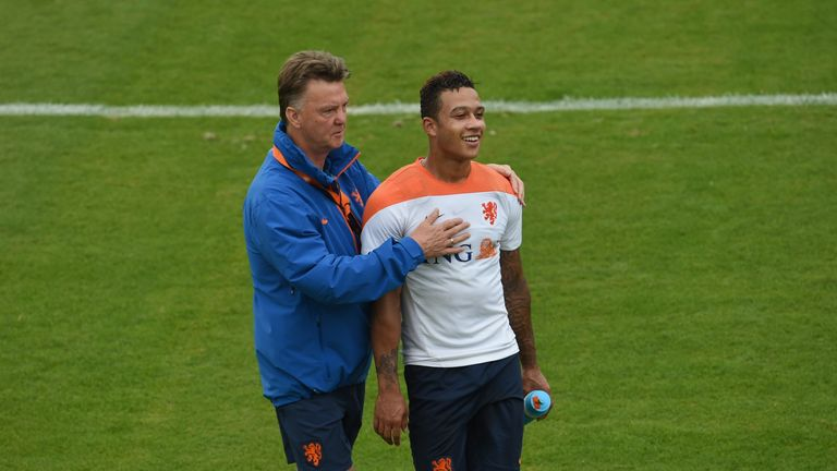 Louis van Gaal shares a light moment with Netherlands forward Memphis Depay during a training session  in Rio de Janeiro during the 2014 FIFA World Cup