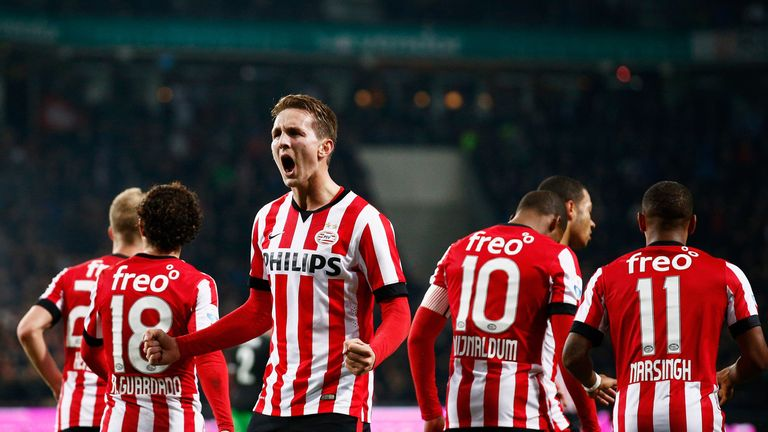 EINDHOVEN, NETHERLANDS - DECEMBER 17:  Luuk de Jong of PSV Eindhoven celebrates scoring his teams first goal of the game with team mates during the