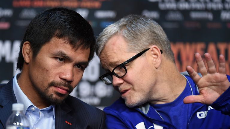 WBO welterweight champion Manny Pacquiao talks with his trainer Freddie Roach