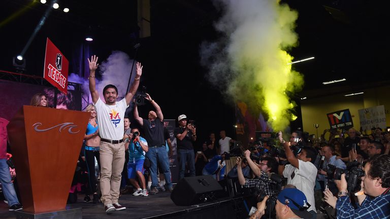 WBO welterweight champion Manny Pacquiao arrives at a fan rally at the Mandalay Bay Convention Center