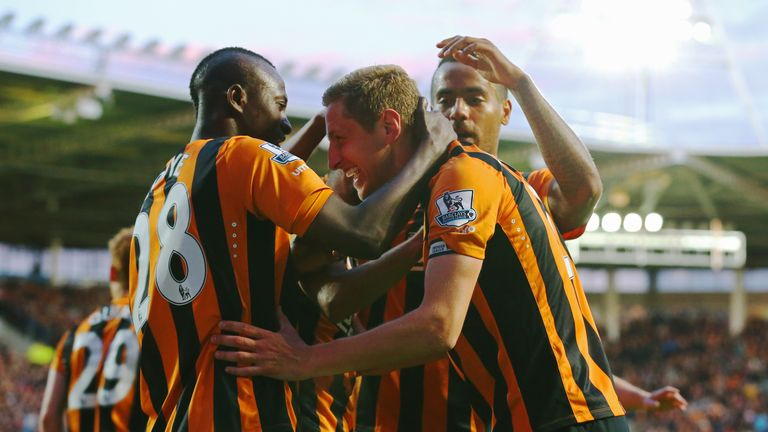 Michael Dawson of Hull City (C) celebrates with team mates as he scores their first goal during the match between Hull City and Liverpool
