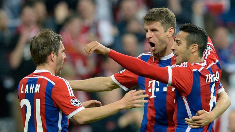 Thomas Muller celebrates his first and Bayern fourth