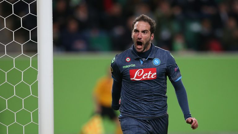 Napoli's Argentinian forward Gonzalo Higuain celebrates after scoring his team's opening goal during the UEFA Europa League first-leg quarter-final