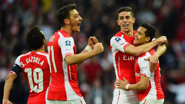 Alexis Sanchez of Arsenal (R) celebrates with Santi Cazorla (L), Mesut Oezil (2L) and Gabriel (2R) as he scores their second g