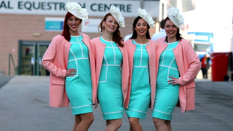 Racegoers arrive for the Grand Opening Day of the Crabbies Grand National Festival