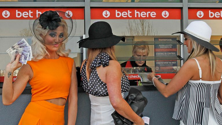 Racegoers place their bets