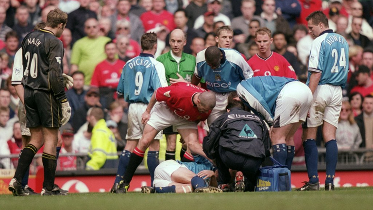 Manchester United's Roy Keane stands over Manchester City's Alf-Inge Haaland following his foul at Old Trafford in April 2001