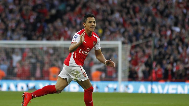 Arsenal's Chilean striker Alexis Sanchez celebrates scoring his second goal during the FA Cup semi-final between Arsenal and Reading