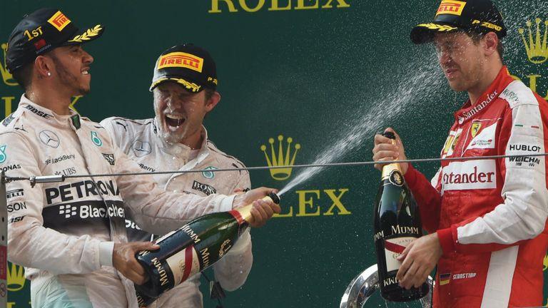 Lewis Hamilton celebrates on the Shanghai podium with Sebastian Vettel and Nico Rosberg