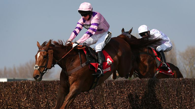 Silviniaco Conti, ridden by Noel Fehily, clears the second last fence on his way to victory in the Betfred Bowl at Aintree