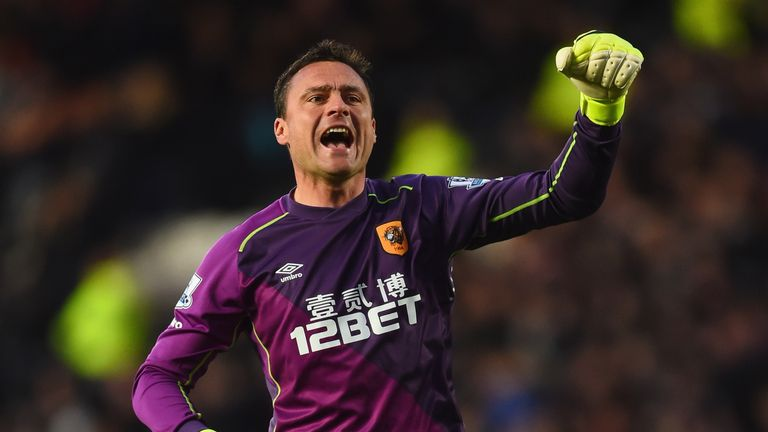 Steve Harper of Hull City celebrates as Michael Dawson scores their first goal during the Barclays Premier League match between Hull City and Liverpool