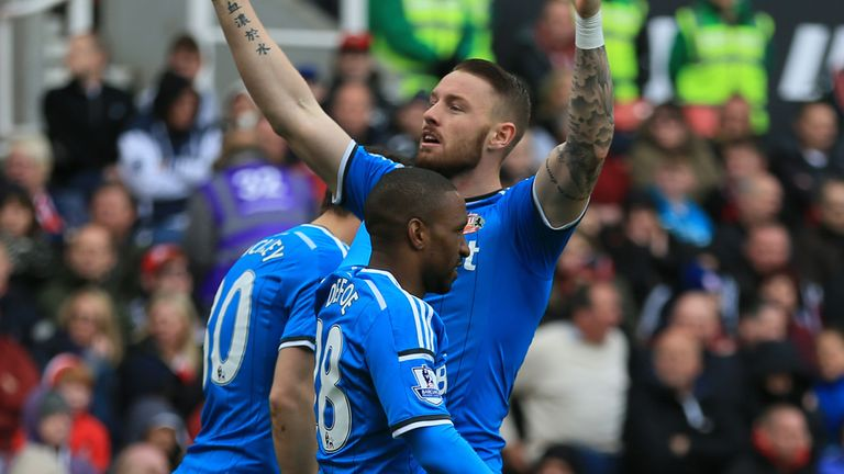 Sunderland's Connor Wickham (facing) celebrates scoring his sides first goal of the game against Stoke City during the Barclays Premier League match