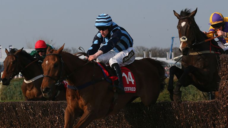 Surf And Turf, ridden by Brian Hughes, clears the last fence on his way to winning the Betfred Red Rum Handicap Chase