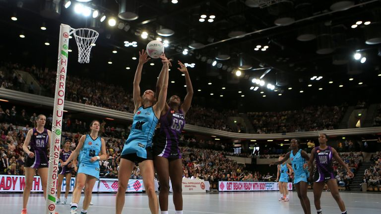 Hertfordshire Mavericks' Sasha Corbin, (right) jumps with Surrey Storm's Hannah Reid, (left)