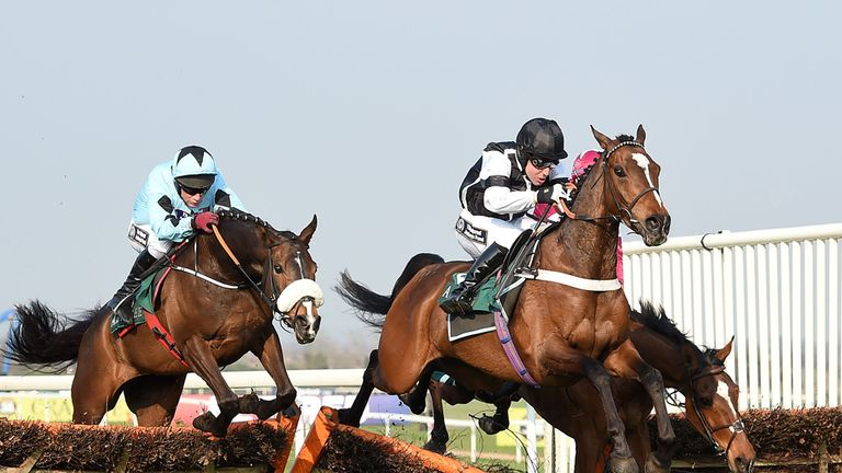Taglietelle (left) clears the last to win the Injured Jockeys Fund Handicap Hurdle Race from Call The Cops