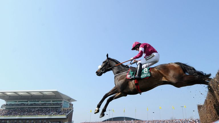 Clarcam ridden by Ruby Walsh clears the final fence to win The One Magnificent City Manifesto Novices' Steeple Chase,