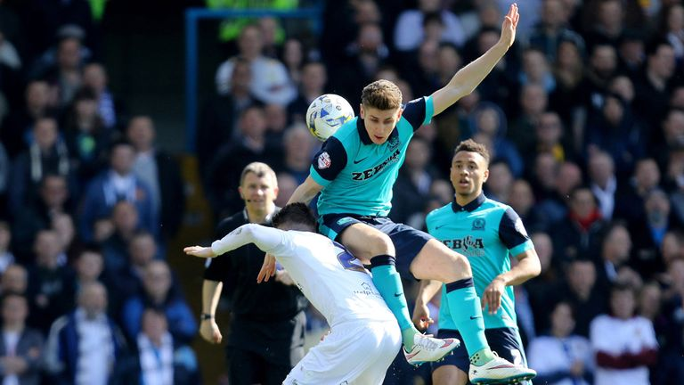 Leeds' Sam Byram and Blackburn's Tom Cairney battle for the ball
