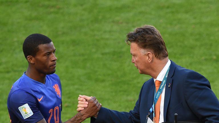 Georginio Wijnaldum is congratulated by Louis van Gaal after World Cup win over Australia