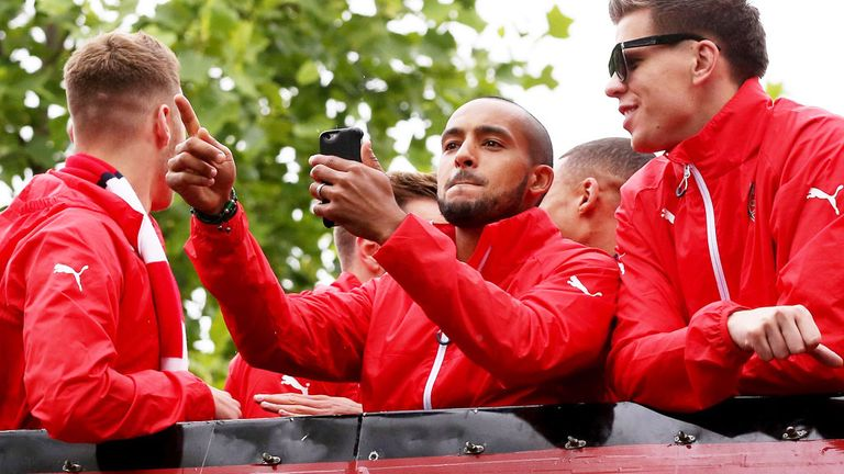 Theo Walcott: Celebrates with team-mates during Arsenal's open-top bus parade