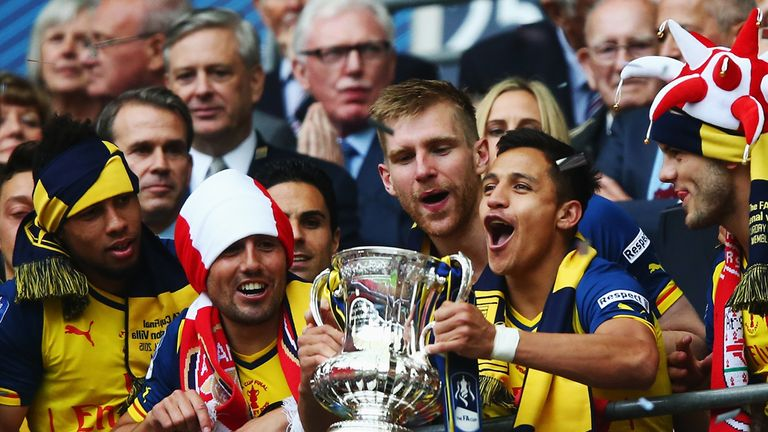 Alexis Sanchez lifts the FA Cup in 2015