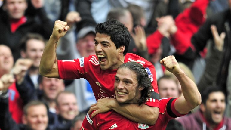 Andy Carroll celebrates with Luis Suarez after scoring the winning goal in the FA Cup semi-final against Everton in 2012