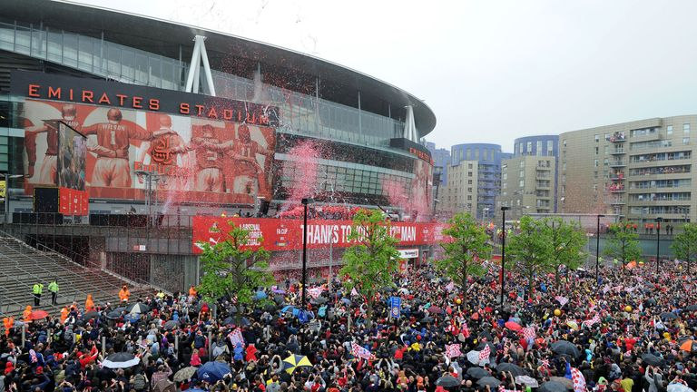 Arsenal's victory parade ended at the Emirates, where thousands had waited to greet them.
