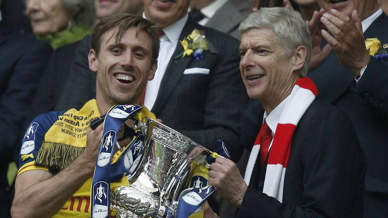 Arsene Wenger lifts the FA Cup with Nacho Monreal
