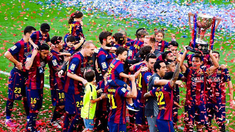 Barcelona players celebrate with the La Liga trophy