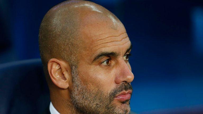 Bayern's head coach Pep Guardiola waits for the beginning of the Champions League semifinal first leg soccer match between Barcelona and Bayern Munich