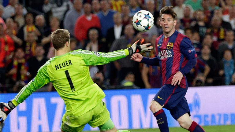 Barcelona's Lionel Messi, right, scores his second goal past Bayern's goalkeeper Manuel Neuer