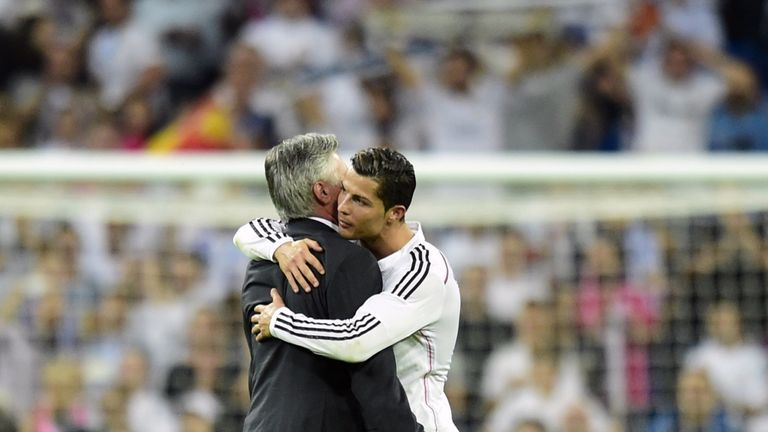 Real Madrid's coach Carlo Ancelotti (L) and forward Cristiano Ronaldo embrace after victory over Barcelona in October, 2014.