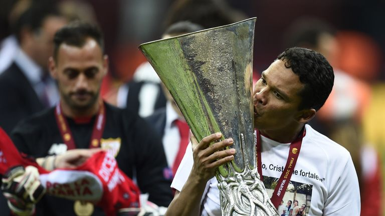 Sevilla forward Carlos Bacca with the Europa League trophy