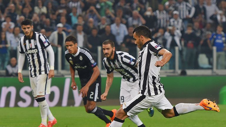 Carlos Tevez of Juventus scores from the penalty spot
