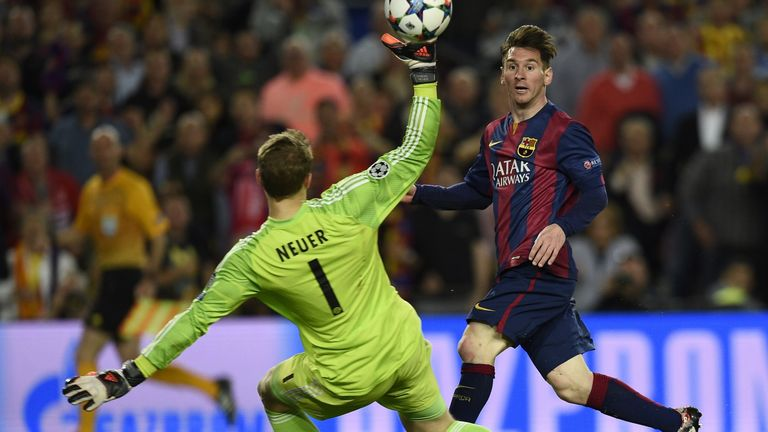 Barcelona's Argentinian forward Lionel Messi (R) scores a second goal