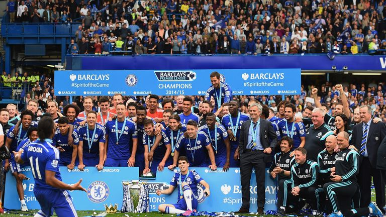 Didier Drogba and Chelsea players and staffs celebrate winning the Premier League