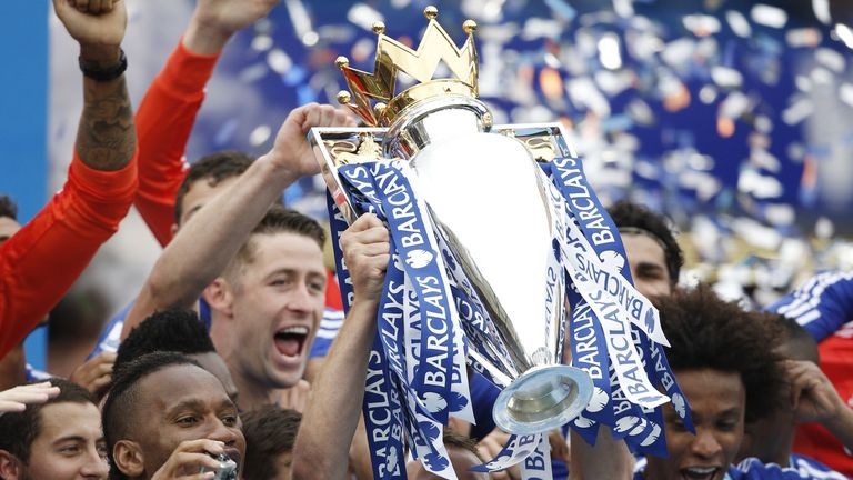 John Terry  holds up the Premier League trophy