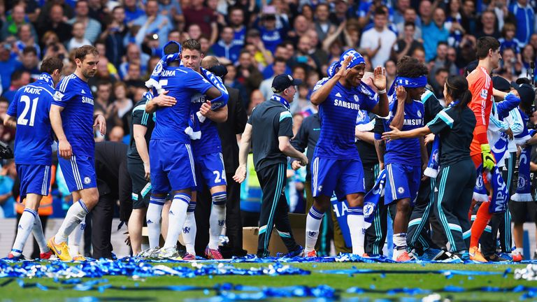 Chelsea players and staff celebrate winning the Premier League title