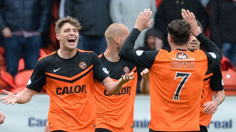Dundee United's Robbie Muirhead (left) celebrates having put his side ahead