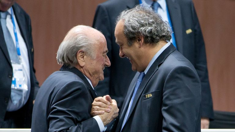 FIFA President Joseph S. Blatter (L) shakes hands with UEFA president Michel Platini during the 65th FIFA Congress at Zurich