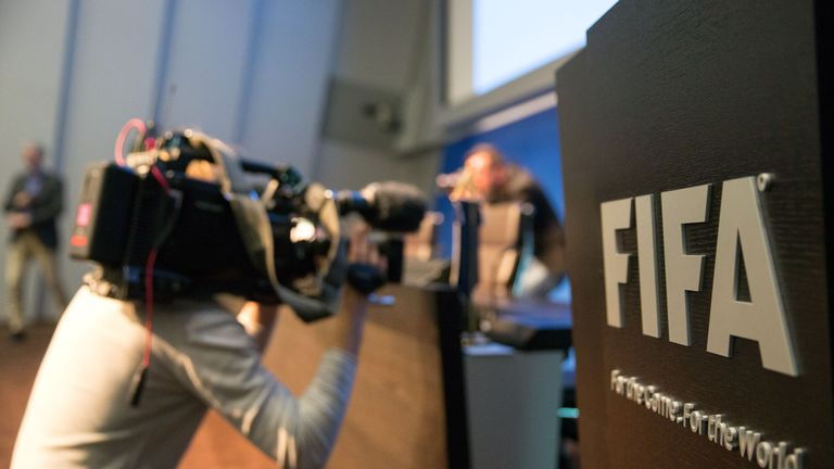 A cameraman attends a press conference  at the FIFA headquarters on May 27, 2015 in Zurich, Switzerland.