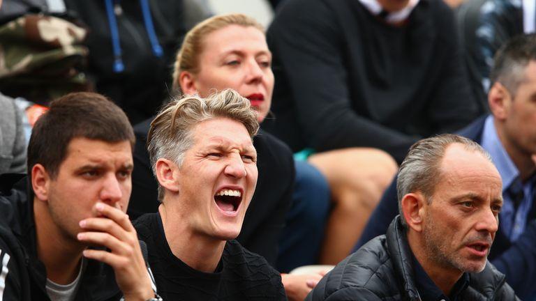 Bastian Schweinsteiger watches Ana Ivanovic