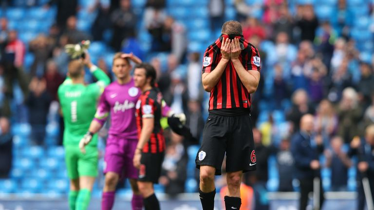 A dejected Clint Hill of QPR and teammates react following their team's relegation.