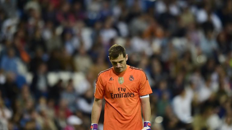 Real Madrid's goalkeeper Iker Casillas looks towrds the ground during the Spanish league football match Real Madrid CF vs Getafe CF