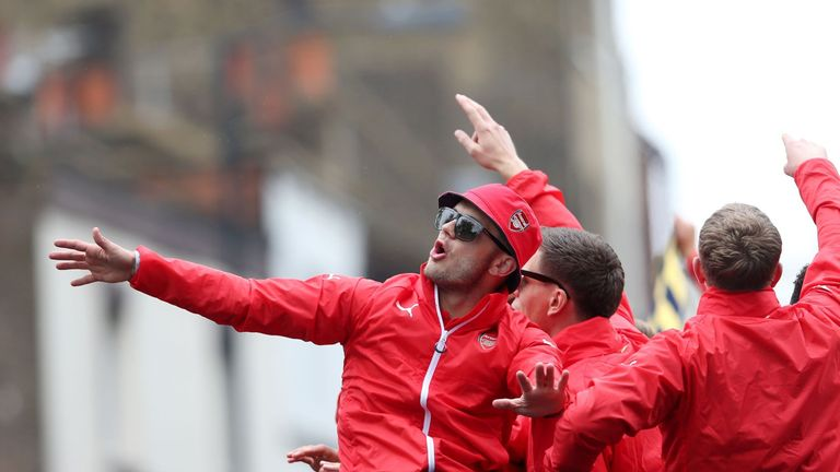 Jack Wilshere (left) and his Arsenal team-mates enjoy an FA Cup victory parade through the London borough of Islington.